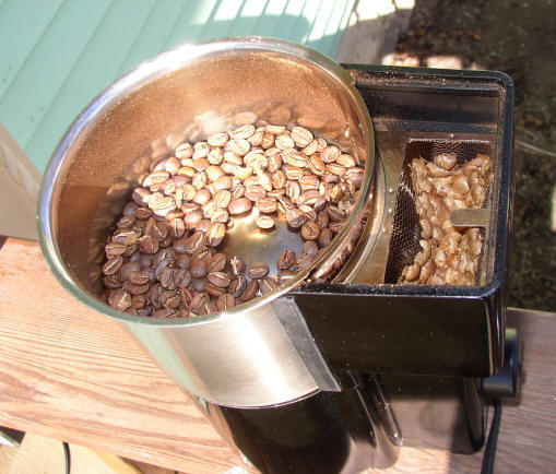 Roasted coffee in roaster.